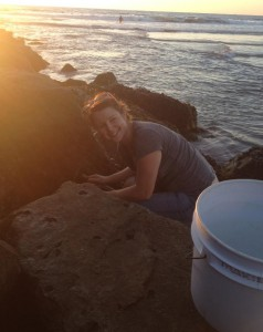 upper body photo of Kate McDaniel crouching over rocks in the rocky intertidal