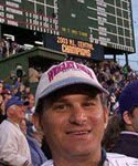 head shot of Brian with a baseball scoreboard in the background