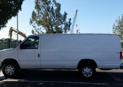 white van parked in an asphalt parking lot